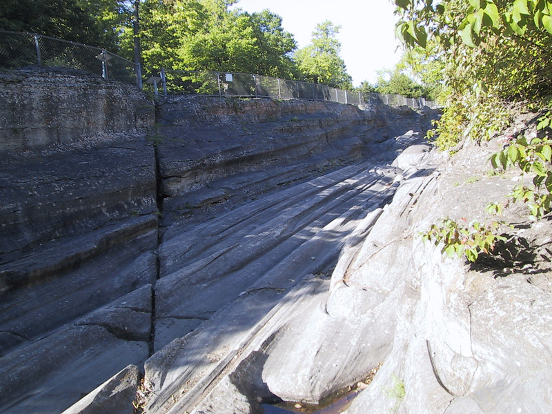 """The <a href=""""http://en.wikipedia.org/wiki/Glacial_striations"""">glacial grooves</a> were cut when glaciers from the last ice age, carrying boulders on their underside, pushed their way through the softer limestone below."""