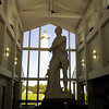 Statue of Oliver Hazard Perry in the visitor center, with the monument in the background.