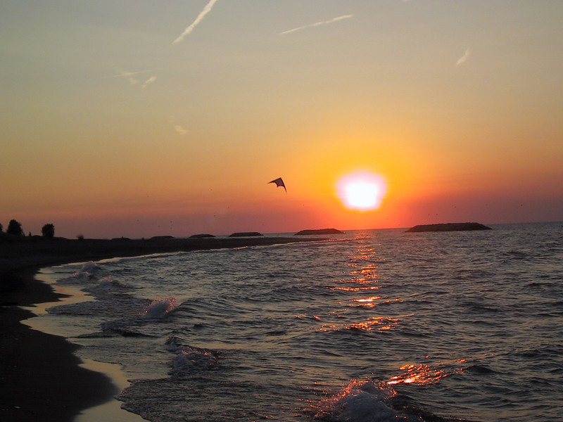 Sunset and a kite at Presque Isle State Park.