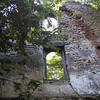 Ruined shell of a house along the main road of Kelley's Island.  The property was for sale.
