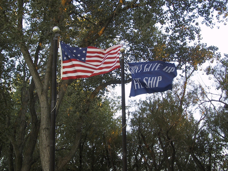 """15-star U.S. flag (the flag during the War of 1812) and a """"Don't Give Up the Ship"""" battle flag.  """"Don't Give Up the Ship"""" was the dying command of Captain James Lawrence; subsequently, his close friend Oliver Hazard Perry adopted it as his motto."""