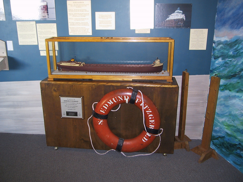 A life preserver from the Edmund Fitzgerald, and a replica of the ship.