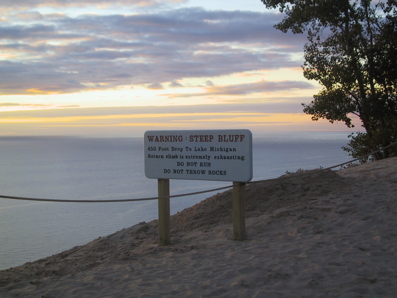 "Near an observation platform in Sleeping Bear Dunes National Lakeshore.  Despite the warning of the ""extremely exhausting"" return climb, tracks beyond the rope indicated that a number of people had tried it."