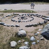 Someone has arranged rocks in a spiral here on the shore.