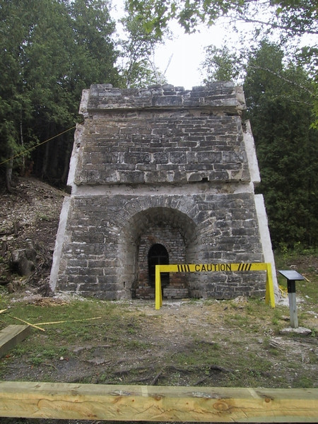 Lime kiln, in which the quarried limestone was converted to lime for smelting.