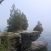 "Cave Point County Park, adjacent to Whitefish Dunes State Park, features these rock formations on the lakeshore.  They are part of the <a href=""http://www.uwgb.edu/dutchs/geolwisc/niagesc.htm"">Niagara Escarpment</a>, a prominent geological feature in the Great Lakes region."