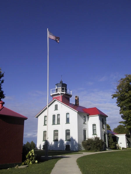 This is the Grand Traverse Lighthouse at the end of Leelanau Peninsula, which marks the western end of the entrance to Grand Traverse Bay.