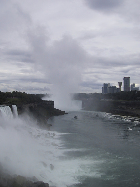 Mist rises from the Canadian falls.