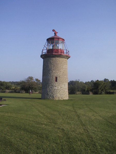 """The False Duck Island light - after being decomissioned, it was moved to its current location on the grounds of the <a href=""""http://www.pecounty.on.ca/government/rec_parks_culture/rec_culture/museums/mariners.php"""">Mariners Park Museum</a>. I was there late in the day and the museum was closed, but I did aid an older gentleman named Sam in moving a metal structure there."""