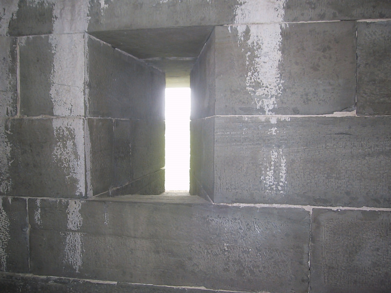 Embrasure in the wall of the fort, allowing soldiers to fire out at attackers while offering minimal exposure to incoming fire