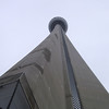 Looking up at the CN Tower from its base