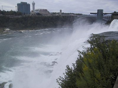 A bridge allows tourists to cross the American part of the Niagara River into Niagara Falls State Park. This is a picture of the American falls seen from there, with an observation deck on the right and more of the Canadian city on the left.