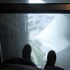 Looking down through the glass floor on the lowest level of the main pod of the CN Tower