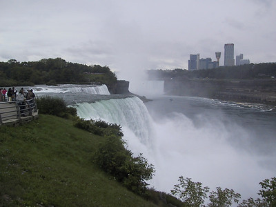 Prologue: I stopped at Niagara falls on the way to Lake Ontario.  The American Falls are in the foreground here, with the Canadian falls and the city of Niagara Falls, Ontario, in the background.
