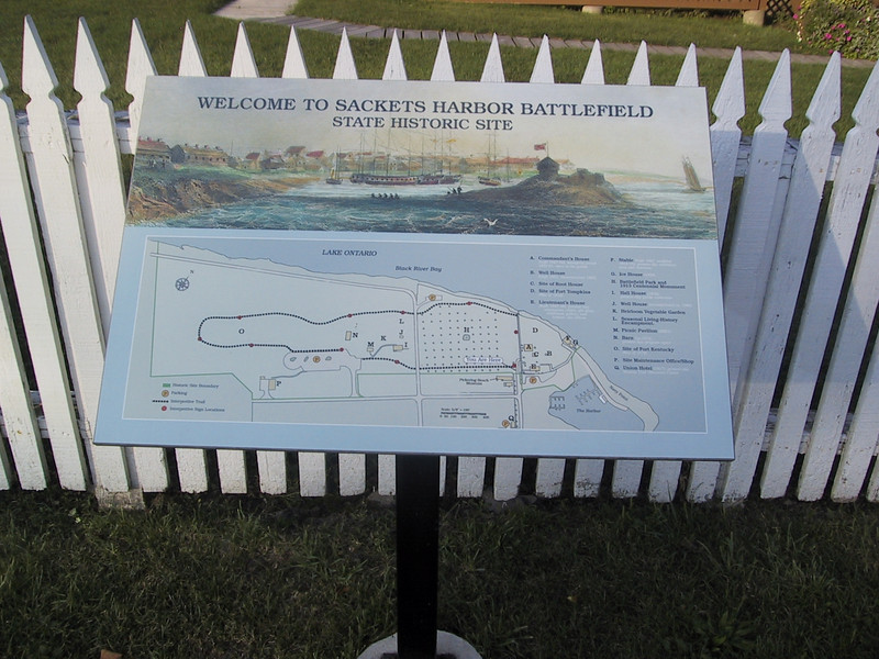 """Sign marking the <a href=""""http://www.sacketsharborbattlefield.org/"""">Sackets Harbor Battlefield</a>, site of a battle in the War of 1812."""