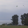 People flying kites on the fort grounds