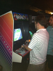 JJ playing a classic Paperboy arcade game