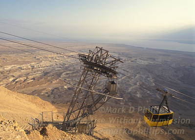 A cable car moves up the side of Masada with the Dead Sea in the distance in Israel.