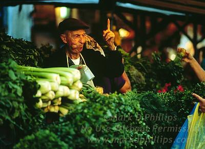 Street Market vendor in Tel Aviv, Israel, sells vegetables