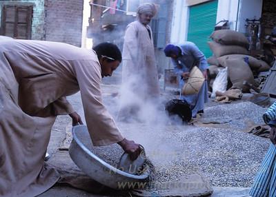 A man roasts pumpkin seeds on the street in Aswan, Egypt.