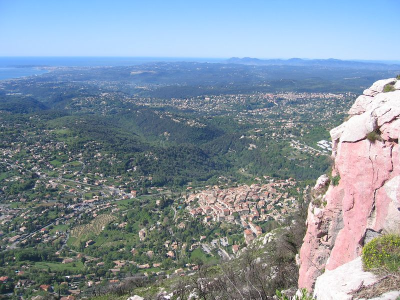At the top of the baou of La Gaude, looking West. The rocks in the forecground are coloured red with fire retardant as there was an enormous forest fire here in 2003. St Jeannet, Vence and St Paul all clearly visible.