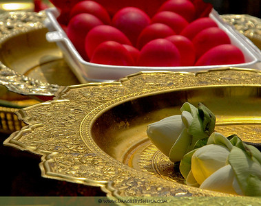 Lotus Flower and Red Eggs offerings at the Buddhist Temple (Bangkok, Thailand)