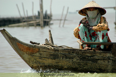 Lady in the boat (Floating Village, Cambodia)