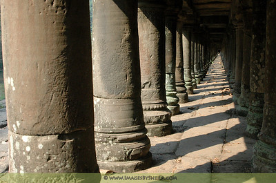 The columns under a bridge at Angkor Wat, Cambodia.