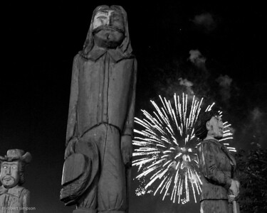 Totems stand watch as fireworks light the harbor of St. John, New Brunswick, Canada.