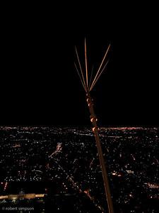 Eiffel tower lighting rod at night.