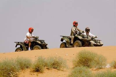 with a quad on the dunes