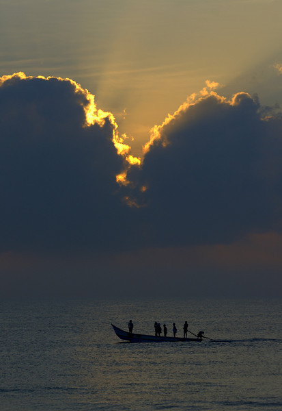 Fishermen, geared up for their early morning catch. Mahabalipuram, India