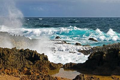 Waves crashing on rocky Aruba coast