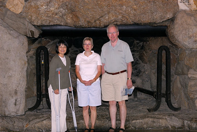In front of one of the fireplaces in the Great Hall