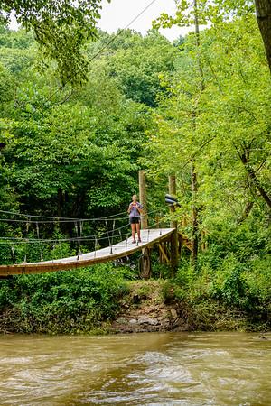 Swinging bridge leading to island and island cabin