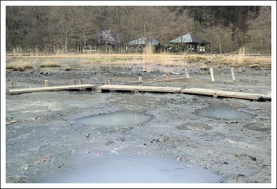 Onsen dera (temple).  The puddles in the foreground are hot springs seeping out of the ground.