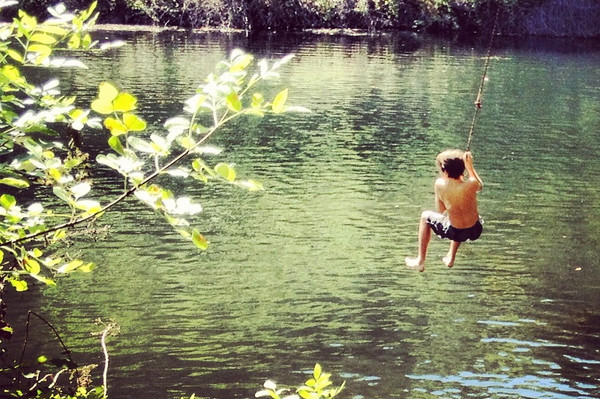 Ipone photo of Sam at the Lithia park swimming resevoir.