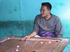 Bar scene in Paro - playing carom.