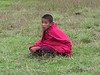 A young monk in the archery field.