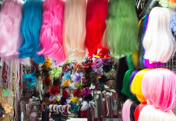 Wigs for sale in a market stall