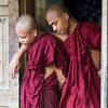 After breakfast, these two monks watched comrades preparing the next meal.