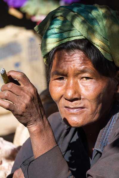 A hill tribeswoman has her smoke