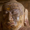 The Buddhas of myanmar have elongated earlobes.