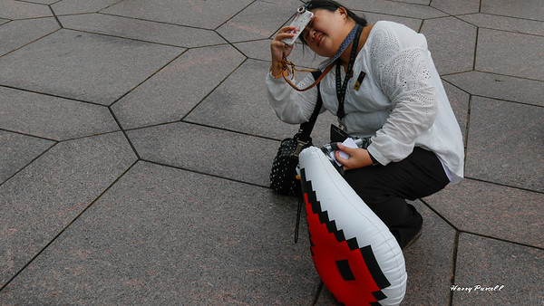 our tour guide in Taiwan, trying to get Taipei 101 photo