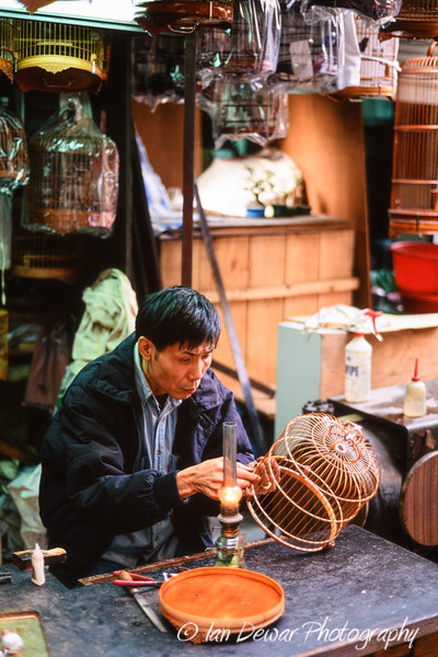 Artisan working on birdcage