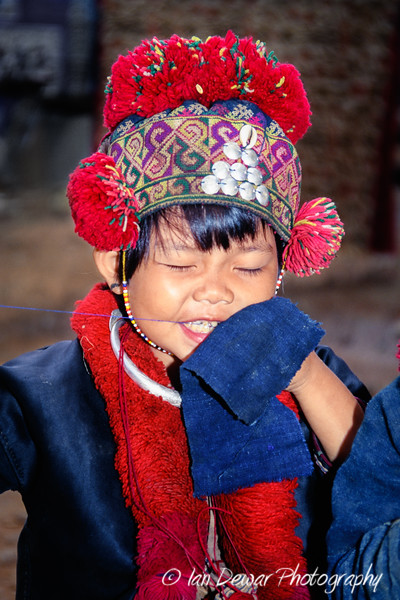 Mien Hill Tribe girl sewing