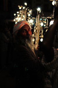 Man Holding Lighting For Holy Festival Procession,  Pushkar, India