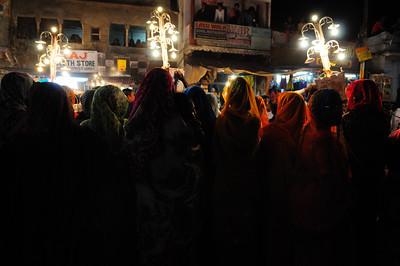 Women Watching Holy Festival Procession,  Pushkar, India