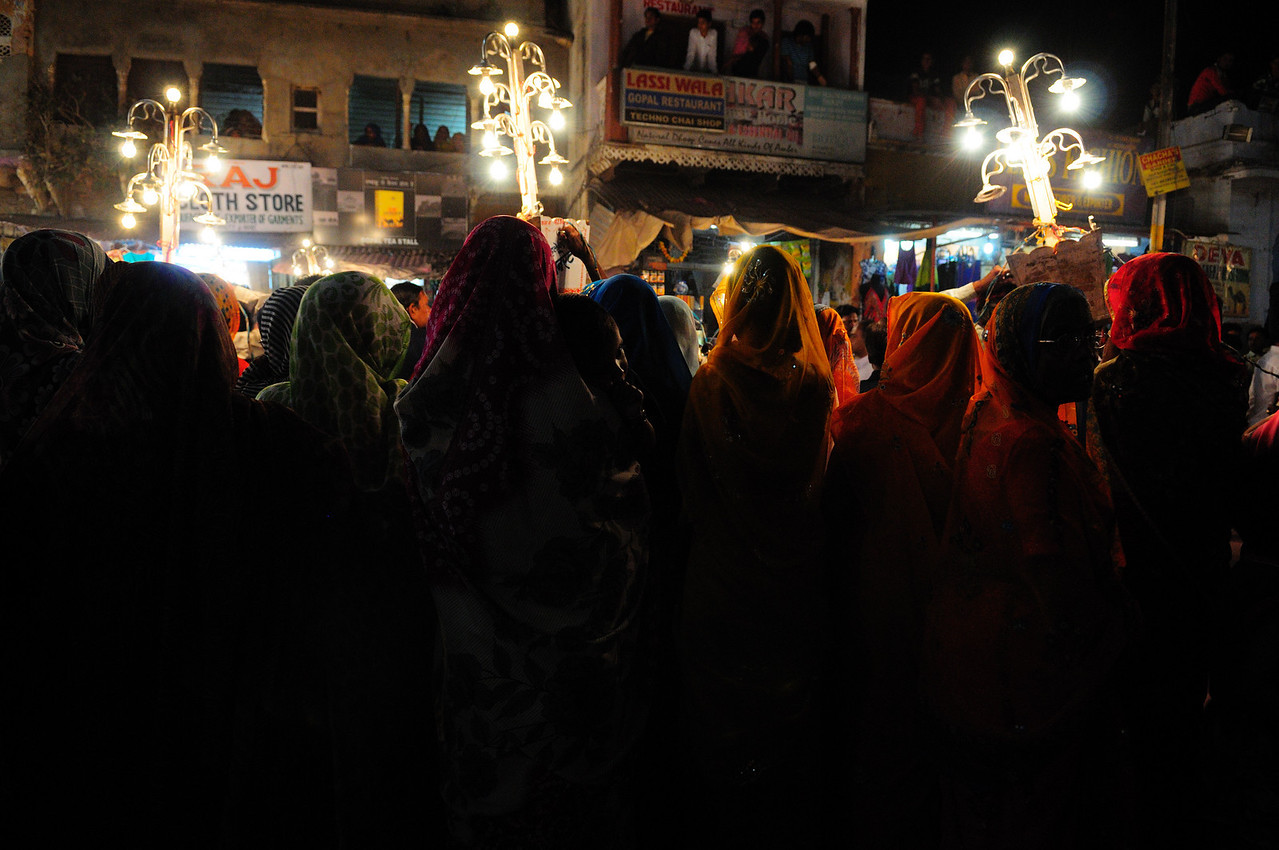 Women Watching Holy Festival Procession, <br /> Pushkar, India