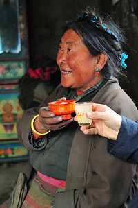Enjoying Barley Beer With Tibetan Family, Tibet